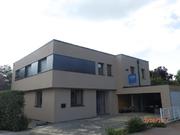 Neues, modernes Flachdach mit 2 Prozent Gefälle für optimale Wasserableitung (K2-Dach). KfW-55 Haus in Gütersloh