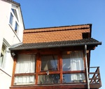 vorher: alte Fassade mit kleinformatigen Asbestplatten