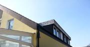 Flachdachgaube, Ortgang und Giebel bekleidet mit Asbestplatten