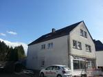 Wohn- und Geschäftshaus vor Dachsanierung.